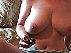 Milf teases herself fo...