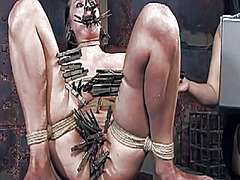 Thumb: Tied up slave receives...