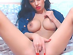 Busty Babe Fingers her...