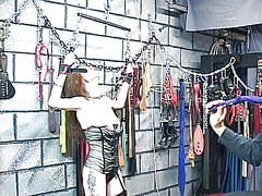 Pretty, thin redhead gets tortured by her master in the dungeon