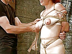 Redhead tied and tortu...
