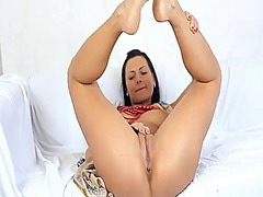 With big jugs and smooth bush gives pleasure to herself with the help of toy