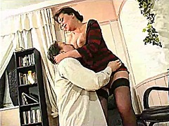 Thumb: Young boy and mature w...