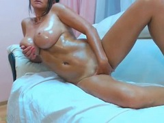 Thumb: Busty mature oiled up