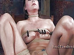 Gagged hotty with clamped nipples gets pleasure