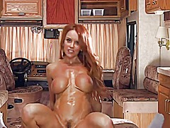 Redhead mature having sex in her rv