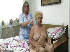Mature woman using dildo on chubby gr...