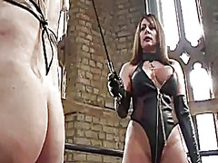 Mistress in latex spanks maid and drops hot wax on big cock