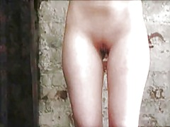 Submissive redhead tortured