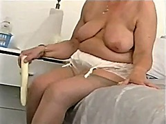 Chubby old granny strips and plays