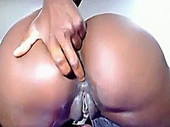 Thumb: Ebony shows pussy on w...