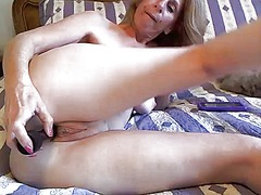 Sexy milf teases her pussy and tits while ...