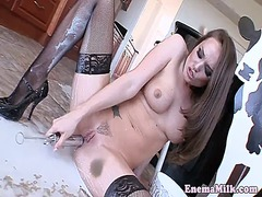 Enema loving babe squirts milk in ass