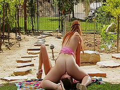 Two petite teens licking in the garden