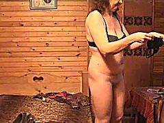 Thumb: Mature lady dressing