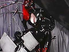 Slave in a rubber suit... - Xhamster