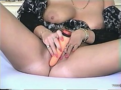 Big-titty milf mastuba...