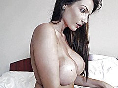 See: Hot brunette topless o...