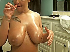 Thumb: Busty milf in a hot cu...